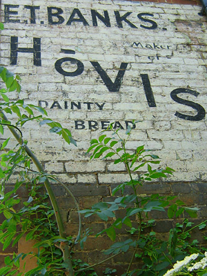 Painted wall advertisement for Hovis bread, in Harrietsham village