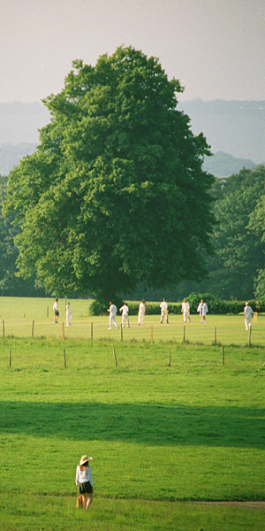 Cricket match in the grounds of Leeds Castle, Kent