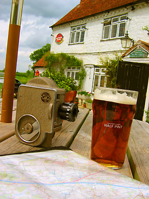 Pint, map, 16mm film camera, beer garden, Pepperbox pub, Fairbourne Heath, Ulcombe, Kent, England, Britain, UK