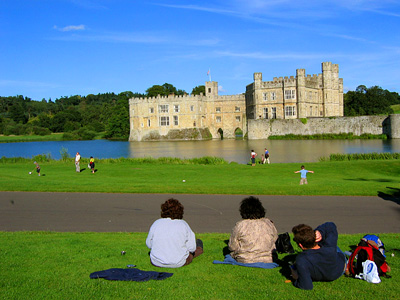 Tea break at Leeds Castle, with view of castle, moat, and grounds