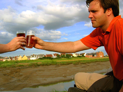 Beers on the riverbank at Rowhedge village